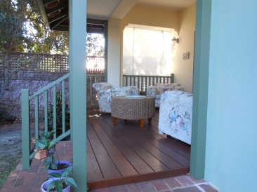 AFTER - New hardwood decking, new balustrade and patio roof